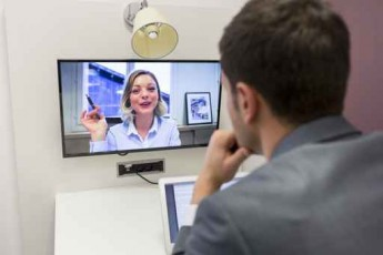 Businessman on video conference with her colleague in office job